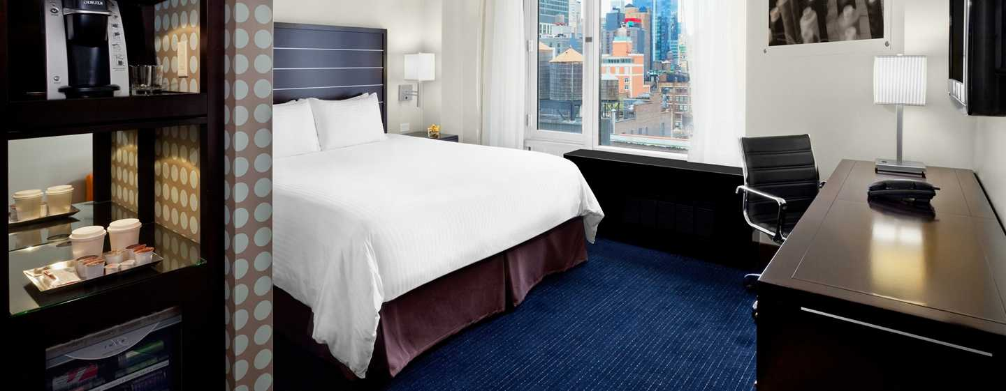 Hilton New York Fashion District hotel - Zimmer mit King-Size-Bett
