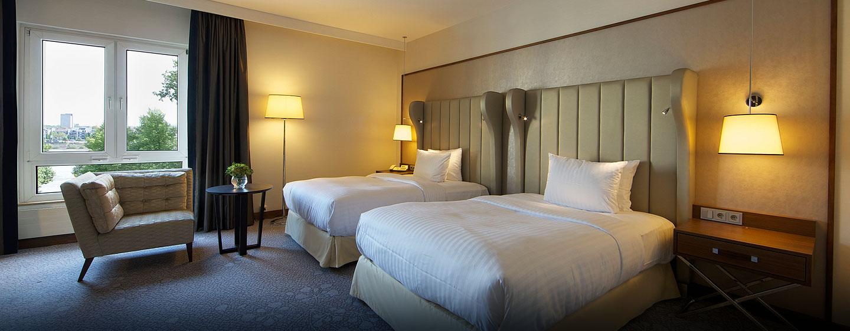 Ihre Reise zu zweit, können Sie im Deluxe Zimmer mit zwei Einzelbetten genießen