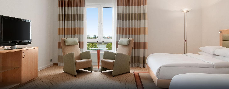 Genießen Sie die bequemen Sessel im Zweibettzimmer