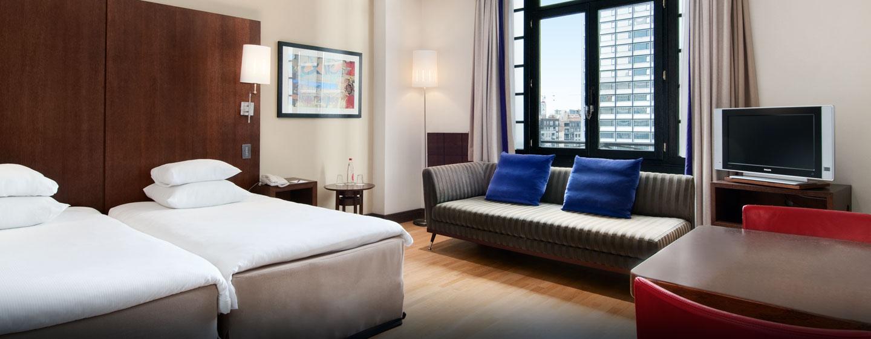 Genießen Sie das großzügige Deluxe Zweibettzimmer mit Blick auf Belgiens Hauptstadt
