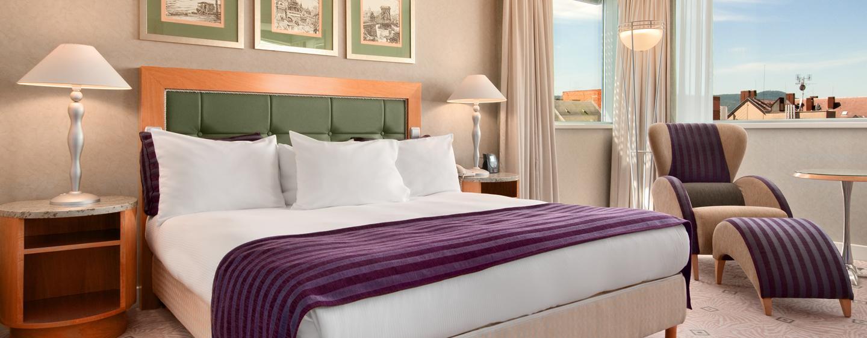 In den geräumigen Zimmer des Hotels können Sie sich nach einem erlebnisreichen Tag in Budapest entspannen