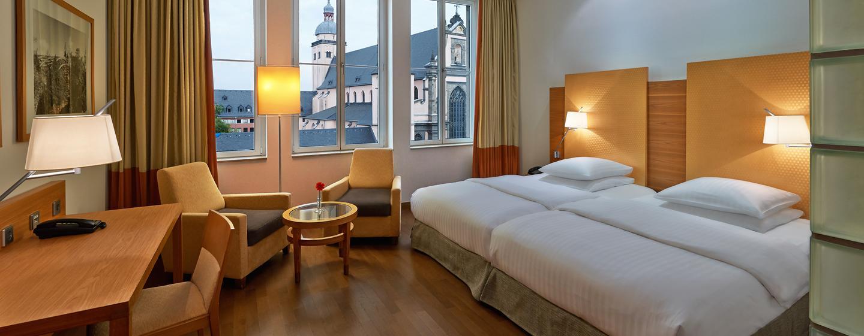Das freundliche Deluxe Zweibettzimmer bietet Ihnen viel Komfort
