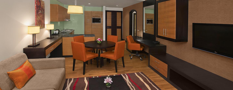 Das Apartment im Hotel bietet Ihnenein separtes Schlafzimmer und ein Wohnzimmer mit Küche und Esstisch