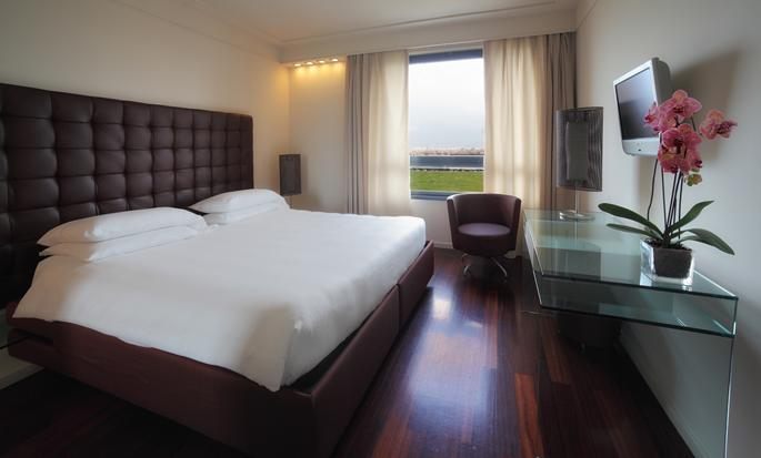 Hôtel Hilton Metropole Florence, Italie - Très grand lit et vue sur la ville