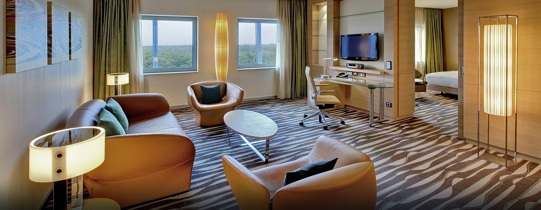 In den Deluxe Suiten kommen Sie in den Genuss von großen Zimmern mit moderner Möbelierung