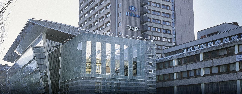 Herzlich willkommen im Hilton Innsbruck, umgeben von dne Tiroler Alpen