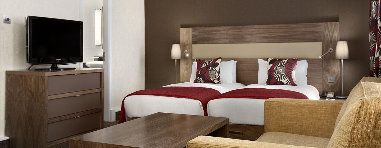 Bei einer Reise zu zweit stellen wir Ihnen gern ein großes Deluxe Zweibettzimmer zur Verfügung