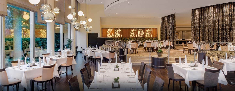 Speisen Sie im Tivoli Restaurant und bewundern Sie den Ausblick auf den Eisbach
