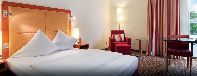 Die hellen und komfortablen Zimmer sind mit Queen-Size-Betten ausgestattet
