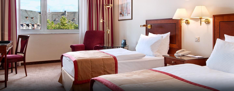 Geräumige Zweibettzimmer laden zum entspannen ein
