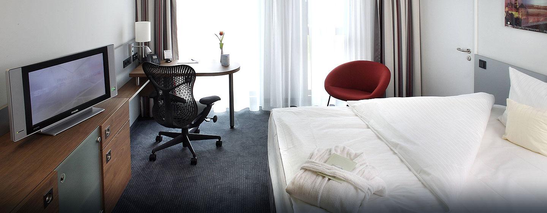 Entspannen Sie nach einem erlebnisreichen Tag in Ihrem modernen und klimatisierten Zimmer