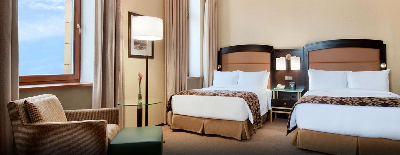 Die gemütlichen Executive Zimmer mit zwei Einzelbetten sind mit einem bequemen Sessel ausgestattet