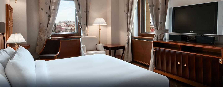 Genießen Sie den Luxus den Ihnen das schöne Schlafzimmer des Suite bietet