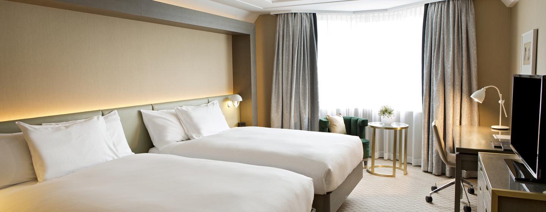 Im Zweibettzimmer können Sie auf Ihrer Reise zu zweit entspannen