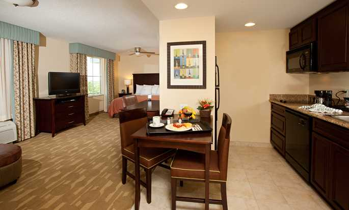 Homewood Suites by Hilton® Lake Buena Vista - Orlando - Studio suite living area, kitchen and bed in the background